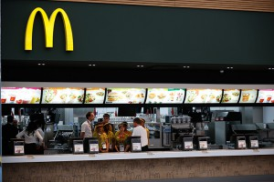 Staff gather in a McDonald's serving area in the athlete's dining hall